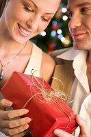 couple giving themself christmas presents