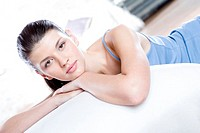 Woman relaxing on sofa (thumbnail)