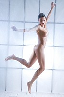 nude woman jumping