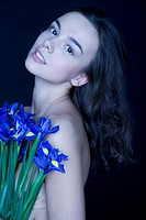 young woman with banch of irises