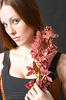 portrait of a woman with cymbidium orchids