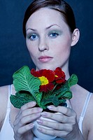 Beauty woman with potted primula (thumbnail)