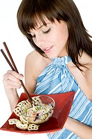 Young woman eating asian noodles (thumbnail)