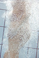 nude woman in swimming pool