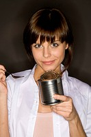 young woman eating from can