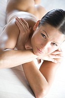 Nude woman laying on stomach (thumbnail)