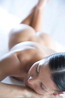 nude woman laying on stomach