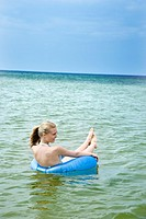 young woman with lifebelt in the sea