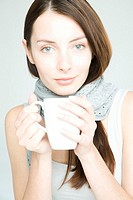 Young woman with white cup (thumbnail)