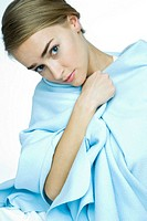 young woman with blue blanket