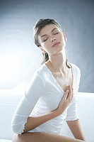 Young woman creaming neckline (thumbnail)