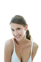 young woman with cream on her face