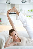 woman stretching at bed