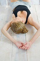 Young woman lying on floor (thumbnail)