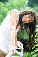 Woman with wet hair in the garden (thumbnail)