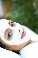 Woman with facial mask (thumbnail)