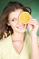 Young woman with orange slice