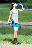 Young woman wearing rollerblades in park