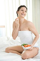 pregnant woman eating carrots