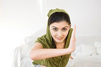 Young woman training tai-chi at home (thumbnail)