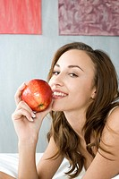 young woman with red apple