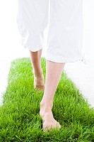 Woman walking on grass (thumbnail)