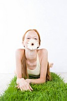 Young woman relaxing on grass (thumbnail)