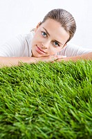 beauty woman laying on grass