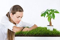 young woman growing plants