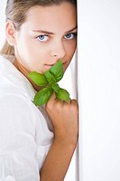 Young woman with fresh basil (thumbnail)