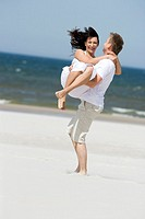 Happy couple on beach (thumbnail)