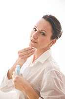 woman cleaning face with tonic