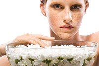 Young woman with bowl full of water and flowers (thumbnail)