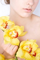 Nude woman with yellow orchid (thumbnail)