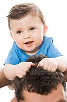 Happy baby on dad\'s head