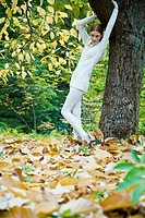 Young woman in autumn landscape (thumbnail)