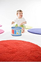 Baby playing on drum (thumbnail)