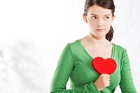 Woman holding heart (thumbnail)