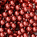 Close up of strings of red beads