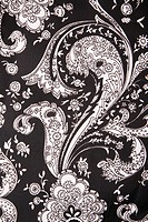 Close_up of black and white vintage fabric with flowers and paisley printed on polyester