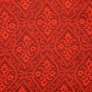 Close_up of red textural vintage fabric with repetitive shapes and designs
