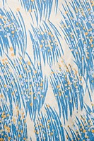 Close_up of vintage fabric with abstract blue and yellow brushstrokes printed on polyester