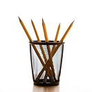 Five pencils in a wire mesh pencil holder