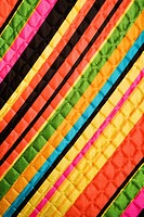 Close_up of bright colorful striped quilted vintage fabric