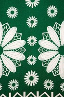 Close_up of vintage fabric with white daisy pattern