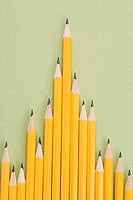 Sharp pencils arranged in an uneven row