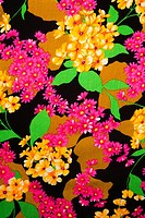 Close_up of vintage fabric with vibrant pink and yellow flowers printed on polyester