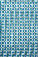 Close_up of woven vintage fabric with repetitive blue and green diamonds