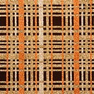 Close_up of woven vintage fabric with brown and gold crossbar pattern
