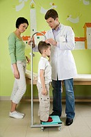 doctor measuring height of child